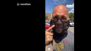 Man wears a mesh mask to prove mandatory masks in Florida is not about protection but compliance