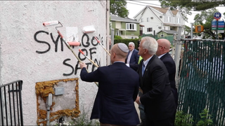 """Officials paint over """"Synagogue of Satan"""" hate speech graffiti on Yeshiva at unity rally"""