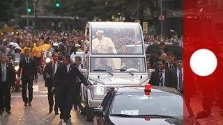 Pope Francis is welcomed by ecstatic crowds in Brazil