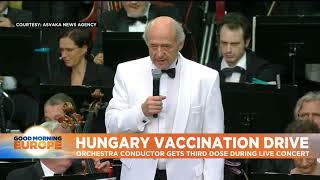 Hungarian-Jewish Conductor Promotes Vaccination by Receiving a Jab While Performing