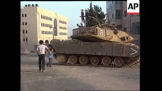 Youths throw stones at Israel Tank