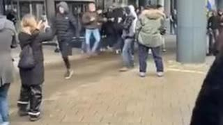 Police agitators get found out at an anti covid lockdown protest in Amsterdam.
