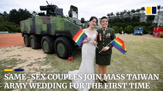 Same-sex couples for the first time marry at Taiwan's mass army wedding