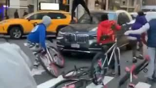 Another angle of the riotous youths swarming & attacking a driver in Manhattan