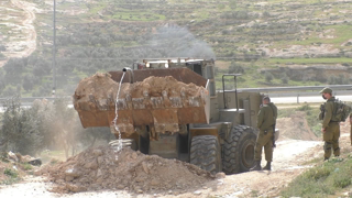 Israeli military blocks road to She'b al-Batem, and destroys pipeline, South Hebron Hills,11.3. 2021