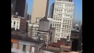GUY WITH CAMCORDER ON HIS ROOF RECORDS EXPLOSION OF TWIN TOWER NO PLANES 911
