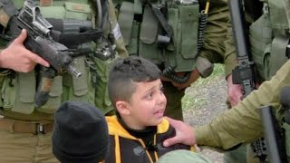 Israeli soldiers drag 8-year-old from home to home looking for stone-throwers, Hebron, March 2017